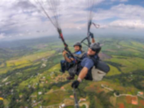 tandem paragliding over cali