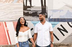 couple with big smiles during engagement session in memphis