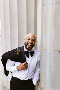 A groom laughing on his wedding day
