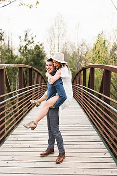 engaged couple piggyback ride