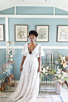 bride laughing with joy in plunge neck wedding gown