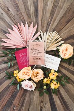 colorful wedding invitations in a beautiful flatlay