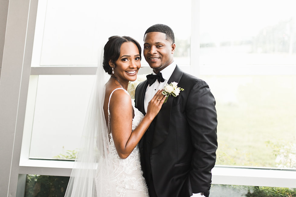 stunning bride and groom smiling in their wedding attire