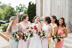 bridesmaids laughing at bride