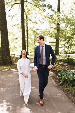 Joyous couple running at the Memphis Botanic Gardens