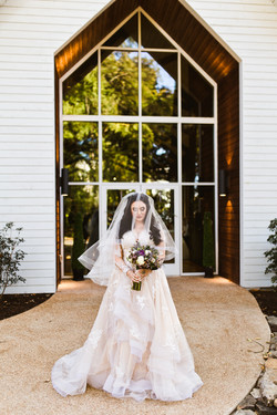 A veil pulled down over a bride's face on her wedding day