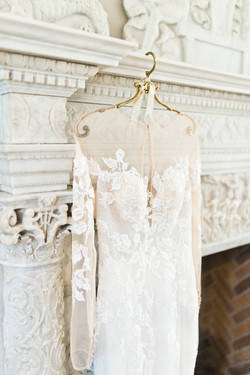 lace wedding gown on vintage fireplace