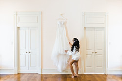 bride looking at wedding gown
