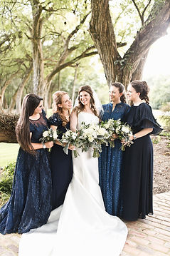 a bride and her sisters smiling on her memphis wedding day