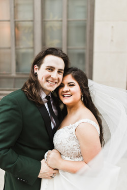 Just married couple with big smiles outside of their downtown Memphis wedding venue