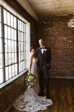 a couple smiling for their wedding formal at 409 south main