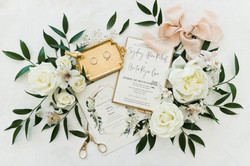 wedding flatlay with wedding rings