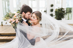 a bride's veil blows in the wind