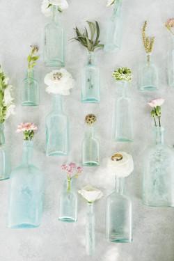 vintage rings on vintage glasss bottles