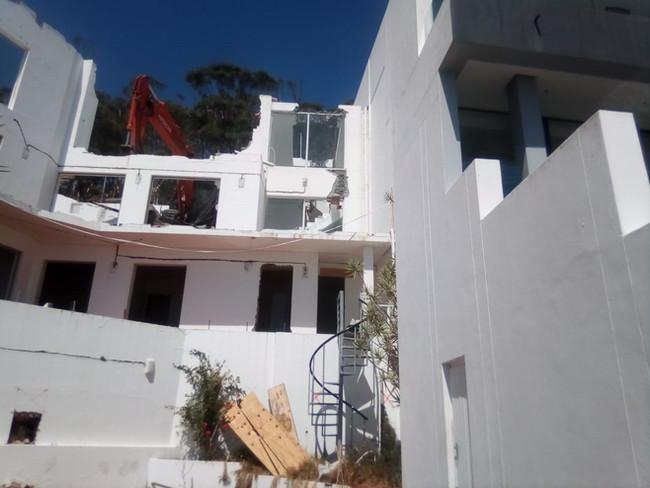A three storey home below street level