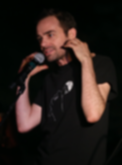 Aaron at mic by David Gonzalez.png