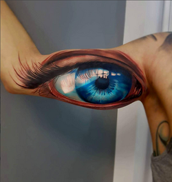 piink-tattoo-piercing-niuniek-tattoostudio-basel-auge-realistic