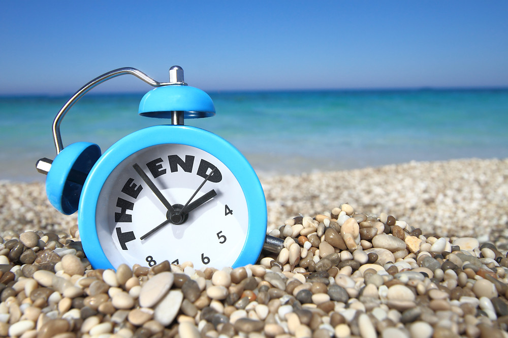 End of summer clock on beach