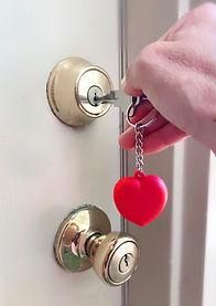 woman-homeowner-unlocking-opening-golden