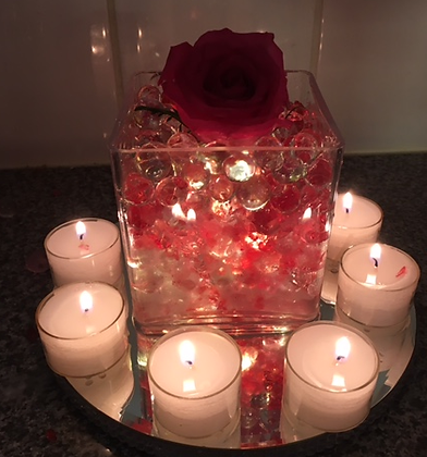 Single rose and water beads and candles