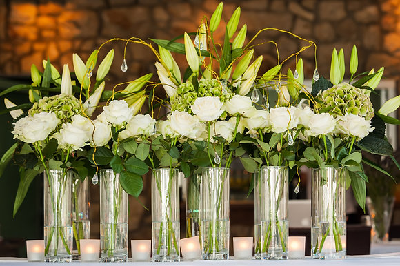 T125- Tall cylinder vase flower display
