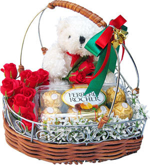Flowers with chocolates and teddy