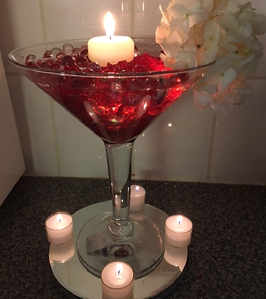 Martini glass with candles and hydrangea