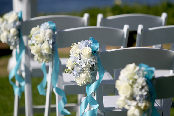 Flowers on chair and chair hire