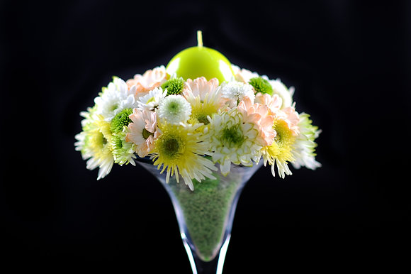 T104 Tall flower centrepiece with candle