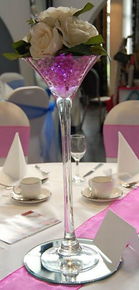 Martini glass with roses and water beads