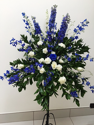 Blue and white flowers on pedastal