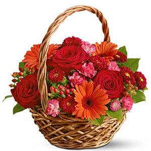 Roses Gerbella and carnations in basket