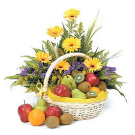 Yellow flowers and fruit basket