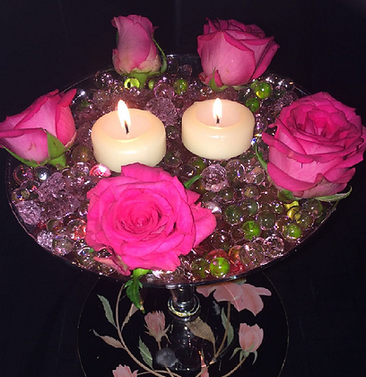 Pink roses with candles