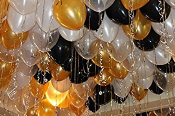 black and gold balloons on ceiling.png