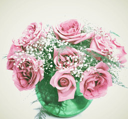 12 roses with gypsy in fish bowl arrangement