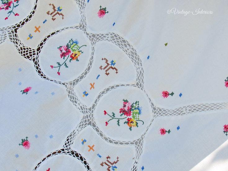 Circular cross stitch roses tablecloth close up