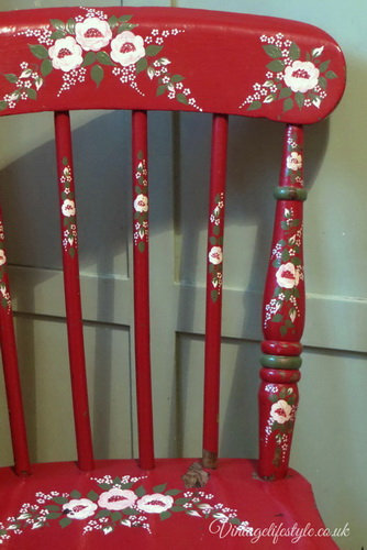 Original floral painted red folk art chair