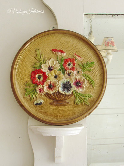 Floral pottery wall plaque