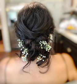 Romantic bridal messy updo hairstyle by
