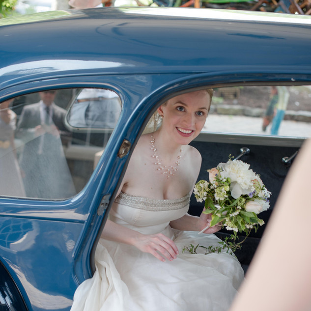 fine art new york wedding photography of a bride stepping out of a classic car