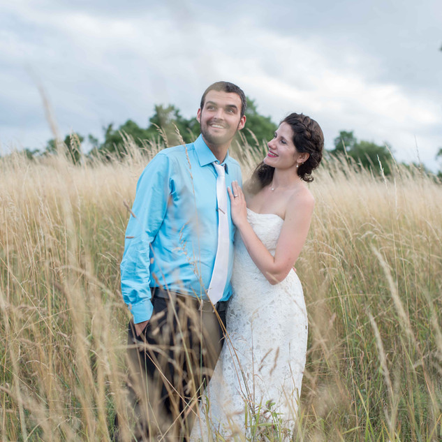fine art new york wedding photography of a bride and groom in tall grass