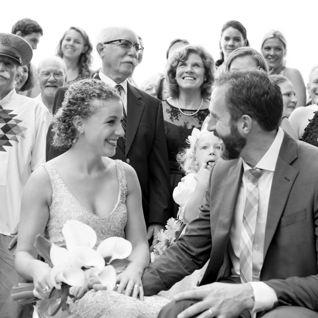 fine art new york wedding photography of a bride and groom with their families smiling