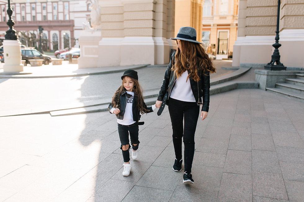 Slim stylish woman in black jeans holdin