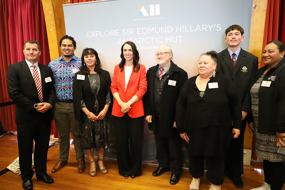 Nigel Watson, CEO of AHT (left) with SEHC leadership team, student leaders and the Prime Minister