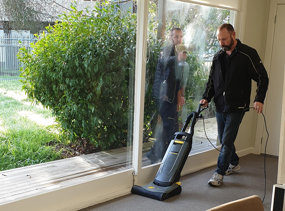 A willing Karcher volunteer helps us clean Hillary House