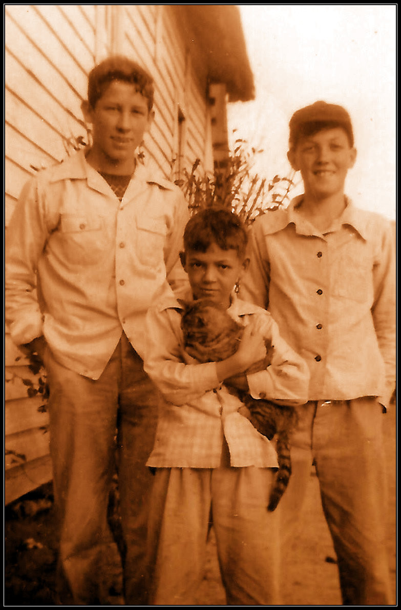 Uncle Ed Griffin, Uncle Royce Carter, and Uncle Vance Carter holding Tom