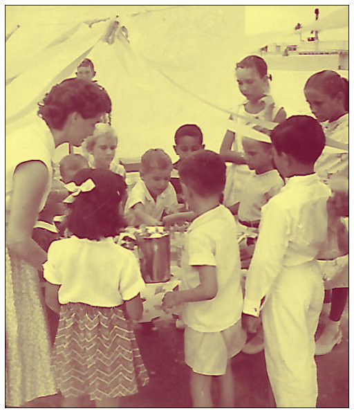Mama, at left, making sure my 5-year party was a hit.  Tripoli, Libya apartment rooftop, 1958