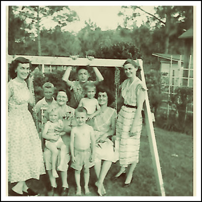 L-R: Aunt Quita, Stan Cheshire, Uncle Vance, Aunt Ceil. FRONT: Grandma Carter holding Wanda Cheshire, Gary Griffin, me, Mama, 1956