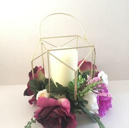 Gold candle floral arrangement.jpg
